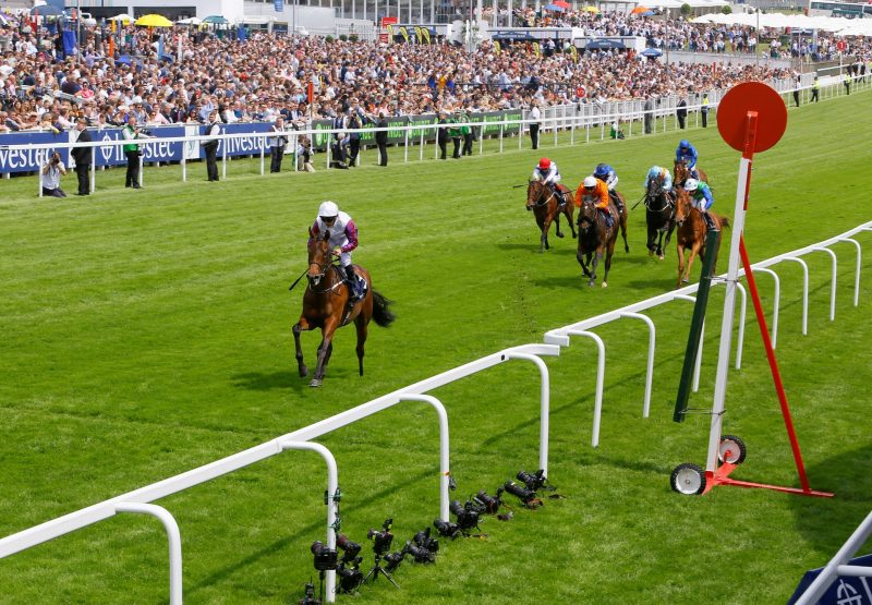 Cosmic Law (No Nay Never) winning the Woodcote Stakes at Epsom