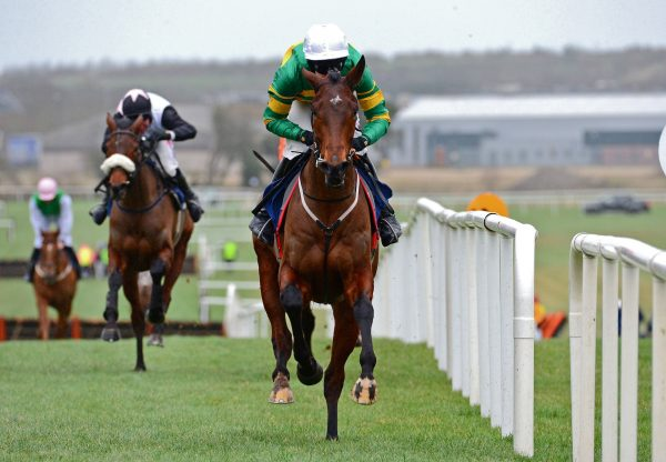Aramax (Maxios) winning a novice hurdle at Naas